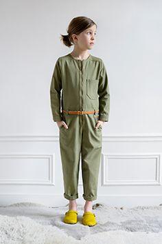 Army green jumpsuit and shocking yellow kicks. #designer #kids #fashion