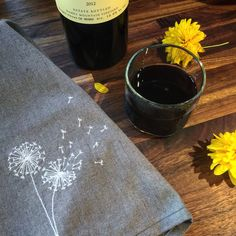 Embroidered Dandelions on hemp and organic cotton towel.