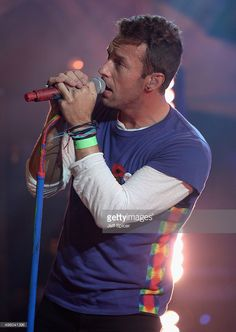 Chris Martin from Coldplay performs during a live broadcast of 'TFI Friday' at the Cochrane Theatre on November 6, 2015 in London, England.