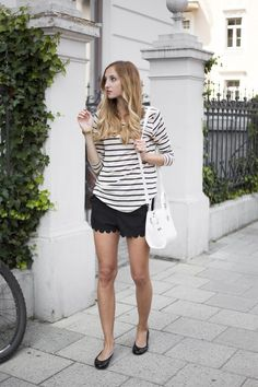Fashion Mugging is wearing black shorts with a scalloped hem. Click for more photos // via bestfashionbloggers.com