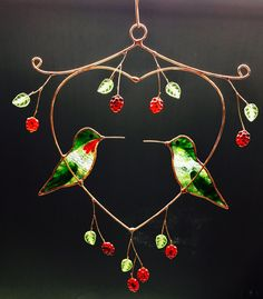 Male and female hummingbirds in a heart shaped copper panel. two of our favourite birds. It hangs approx. 6 inches wide and 10 inches long and comes with a 1.5 feet long copper chain for hanging.