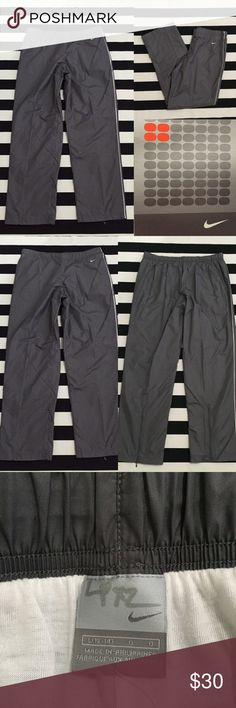 """NWT[Nike] women's grey athletic track pants szL [Nike] women's grey athletic track pants szL •listing •NWT, new with tags condition •grey with light purple stripe detail, embroidered logo •length/inseam 31.5"""" •material 100% polyester, feels like lined windbreaker pants •2 front pockets, elastic drawstring waistband, pant leg zippers •offers welcomed using the offer feature or bundle for the best discount• Nike Pants Track Pants & Joggers"""