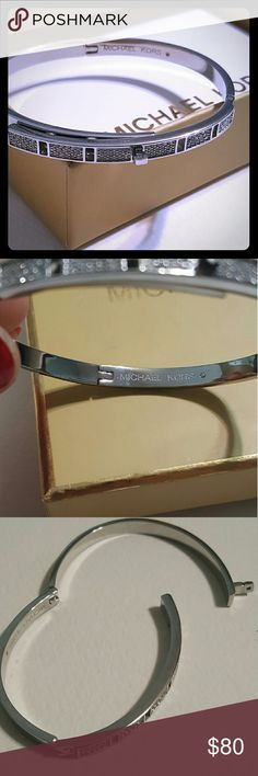 """Michael kors silver diamond bracelet Brand new with tags. I've never worn this it's just been siting in the box.   Silver bracelet  7""""-7 1/2 size Michael Kors Jewelry Bracelets"""