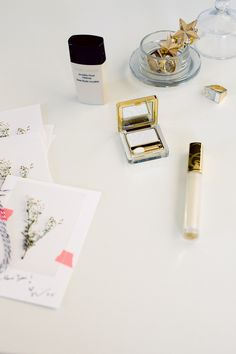 White lipgloss and eyeshadow from Estee Lauder to make the face glow