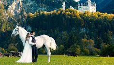 A fairy-tale romance is captured in this photo where Jay Chou and Hannah Quinlivan are dressed like a prince and a princess with a white stallion, in front of Neuschwanstein Castle in Germany. --