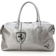 Ferrari Puma duffle bag Used a few times for trips. Great duffle bag for carrying on or weekend trips. From the puma Ferrari line. Puma Bags Travel Bags