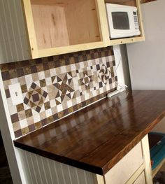 Easy cheap DIY backsplash: self-adhesive vinyl floor tiles, made into quilt block patterns