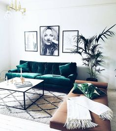 Boho-inspired living space with black and white art and green accents