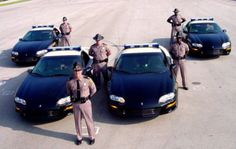 Florida State Troopers and patrol vehicles