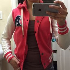 Letterman sweater jacket Pink and white, with hoodie, and botton down buttons, super warm. Has a small stain on sleeve. Not noticeable at all. Make an offer!! NO TRADES OR LOW BALL PRICES. Papaya Jackets & Coats Utility Jackets