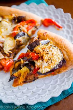 Homemade Whole Wheat Pizza Crust (that actually tastes good!) piled high with roasted veggies. Pizza night just got a little healthier!