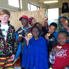 Doughnuts and Surf time. Ollie Morris spends his school community service time with the GROMS on the Surfshack Surf Outreach Cape Town.