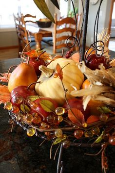 This would be such a cute centerpiece...love fall decor!