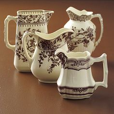 Two's Company Brown Tranferware Pitchers (Set of 4 Asst): A set of four assorted brown transferware on white porcelain classic pitchers for the collector.  From 7 1/2