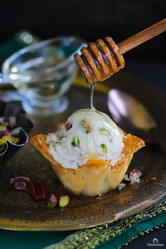 A fun summer spin on the Mediterranean favorite! Crispy phyllo cup sweetened with cinnamon honey syrup, topped with a scoop of an easy to make candied nuts cinnamon ice cream. Frozen Desserts, Easy Desserts, Delicious Desserts, Cinnamon Ice Cream, Honey And Cinnamon, Best Nutrition Food, Cheese Nutrition, Nutrition Bars, Phyllo Cups
