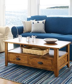 "With its unique character and handsome good looks, this coffee table will easily become the centerpiece of your living room. This rustic piece is handcrafted from rough-sawed pine that's sanded by hand, stained and finished with a durable low-sheen topcoat. No two pieces are exactly alike. Two drawers and an open shelf provide storage space.  20""H x 48""W x 26""D"