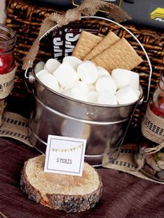 s'mores pails for a camping themed bridal shower.