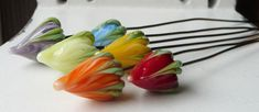 Rainbow Flowerbud Headpins by Sabrina Koebel of SabrinaDesign  Gorgeous Flowerbud Headpins by the Each! I call them Rainbow because lining