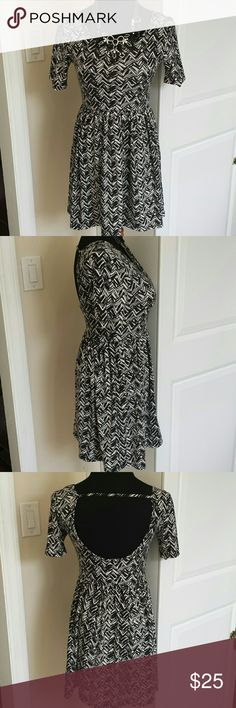 Geometric print open back babydoll dress Super soft and stretchy babydoll style dress with unique black and white geometric pattern. Pair with tights boots or booties and a cardigan for colder weather. Tagged size S but fits more like an M! Feel free to make an offer! Dresses