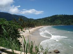 Maracas Beach, Trinidad.  It looks like a pirate ship should sail right into the cove.