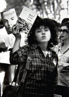 "A young Iranian communist holding two books about Russian history in her hands, one titled ""History of the Russian revolution"" and the other is titled ""Young Lenin"". Tehran, Iran (Circa 1979) Iranian leftists promoted their ideology during and after the Iranian revolution, before the crackdown by the new Islamic regime. Iranian Women, Russian Revolution, Tehran Iran, Revolutionaries, Communism, Soviet Union, Persian, World History, Middle East"