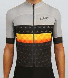 Cycling short sleeve jersey from our Triangle Jungle collection. Main color is dark and bright grey with some orange pattern.