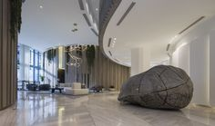 An Exclusive First Look Inside Miami's Beautiful OMA-Designed Park Grove. A lobby is full of art, wood paneling, and vegetation. Lush, Grove Park, Beach Design, Design Miami, Coconut Grove, Zaha Hadid Architects, Modern Artists, Contemporary Interior, Front Desk