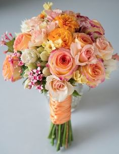 Wedding Flower Arrangements The Peach Sorbet Bouquet - A delightful mix of peach roses and seasonal flowers wrapped in a satin bow. Bridal Flowers, Flower Bouquet Wedding, Floral Wedding, Elegant Wedding, Peach Flowers, Peach Bouquet, Pastel Bouquet, Orange Roses, Luxury Wedding