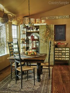 In our September 2016 issue: Antiques and country collectibles help a Washington-state homeowner give a new ranch timeworn charm. (Photographed by BlackstoneEdge.com, styled by Donna Pizzi)