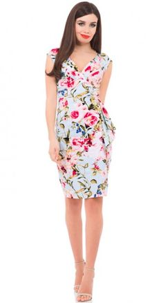 Pretty as a petal, the Rose Vine Pencil Dress is a timeless floral beauty. Set on a pale blue cotton blend, the flowers and leaves stand out perfectly.