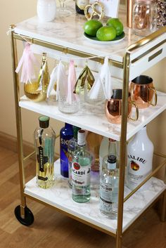 IKEA Hack: Gold & Marble Bar Cart, by Twinspiration: http://twinspiration.co/ikea-hack-gold-marble-bar-cart/