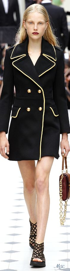 The black coat with golden lining and buttons looks luxurious. It can look…