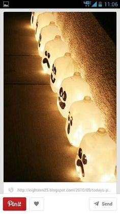 These would be cool...simple decorations. We could put some glow stick in them. Start saving milk jugs girls!