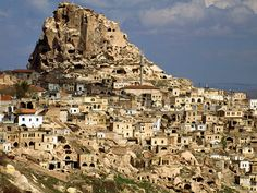 (Turkey) - Cappadocia - Land of fairy chimneys ,In the middle of modern-day Turkey lies a unique lunar landscape of caves, tunnels, and hundreds of entire underground cities that span for miles, which were first carved out by the pagan Hittites over 3,000 years ago. Called Cappadocia, this land of lost cities has secrets inside every cave and around every corner -- from honeycombs of tunnels rigged with booby-traps to the clandestine routes of fierce battle.