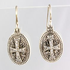 Sterling Silver with Pave Cross and really intricate work.  Pretty!