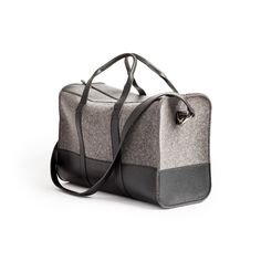 The Weekender   This wool felt weekend bag with leather accents ensures you'll look good getting there. Felt and leather are the best pairing since Saturday and Sunday.