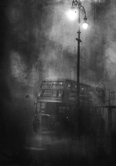 A near abstract image full of foreboding. A Routemaster bus glimpsed emerging from the fog - London 1952