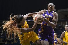 Candice Wiggins #2 of the Tulsa Shock forces a jump ball against Nneka Ogwumike #30 of the Los Angeles Sparks during the WNBA game on September 6, 2013