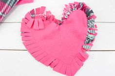 These valentine pillows are so easy to make! They use the classic summer camp fleece tie pillows method and are the perfect Valentine's Day crafts for tweens and big kids. Valentine Crafts For Kids, Valentines Day Decorations, Valentines Diy, Crafts For Teens, Crafts To Make, Arts And Crafts, Kids Crafts, Paper Crafts, Tie Pillows