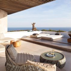 Just look at this absolutely stunning #terrace with #seaview and tasteful #furniture! The team at ARRCC did a really good job! Browse #homify for more #designs for your #home!  #design #moderndesign #interior #interiordesign #terracedesign #terraceideas #outdoor #outdoorspace #lounge #loungefurniture #views #view #sea #ocean #modernliving #relax #enjoy #unwind