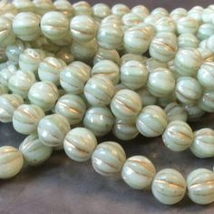 6mm Czech fluted melon beads in mint with gold wash.