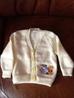 Cream hand Knitted baby cardigan with Winnie by Happilyevercrafts, £12.00