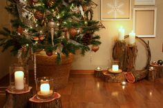 Like the use of the wooden log pieces for candleholders or to display other Christmas items