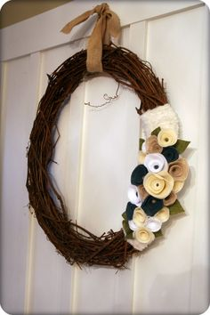 Felt flowers are getting big 'round here, and I love grapevine wreaths.