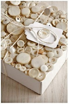 Box of cream colored buttons