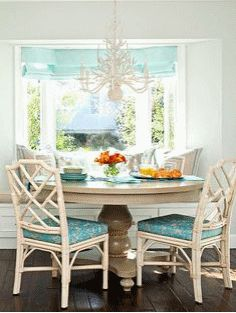 Mix & Match: Who says you can't mix syles? The traditional-style table is complemented by airy chairs and a beachy chandelier. Color & beach accents pull it all together for a warm & welcoming cottage feel.