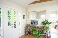 Refinery29 interviews Whitney Leigh Morris about small space tips she's learned from living in her Tiny Canal Cottage.