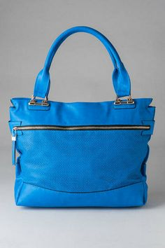 "Make a statement with the Washington Perforated Tote. This faux leather bag features a front perforated panel along with a large zipper pocket. Finished with an exterior zipper pocket on the back, one interior zipper pocket, and two open pockets. Pair with a cute skirt and some wedges!<br><br>    - 17.5"" width x 12"" height x 4"" depth<br>  - 8"" handle drop<br>  - Imported<br>"
