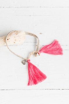 dainty bracelet with tassels.