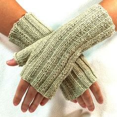 Knit flat and seamed, these are simple to knit and will quickly become your favorite go-to fingerless gloves. Ours were knit using 1 ball of LanaMundi Yarns SilverSpun - an American made cotton yarn spun with pure silver.